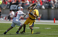 Ohio State's Evan Mulchrone (39) knocks the ball away from Michigan's Mike Hernandez (16) in the second quarter of the NCAA lacrosse game between the Ohio State Buckeyes and Michigan Wolverines at Ohio Stadium in Columbus, Saturday morning, April 12, 2014. The Ohio State Buckeyes defeated the Michigan Wolverines 15 - 6. (The Columbus Dispatch / Eamon Queeney)