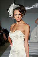 Model walks the runway in an Ivana wedding dress by Katerina Bocci during the Wedding Trendspot Spring 2011 Press Fashion, October 17, 2010.