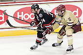 Vinny Saponari (NU - 74), Patrick Wey (BC - 6) - The Boston College Eagles defeated the visiting Northeastern University Huskies 3-0 after a banner-raising ceremony for BC's 2012 national championship on Saturday, October 20, 2012, at Kelley Rink in Conte Forum in Chestnut Hill, Massachusetts.