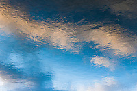 Reflection of clouds and sky in a lake at the Styadtwald in Krefeld, Germany.