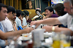 """Customers enjoy dinner and a chat with a geisha aboard a """"Yakata-bune"""" pleasure boat run by Harumiya Co. in Tokyo, Japan on 30 August  2010. Photographer: Robert Gilhooly"""