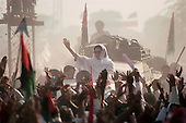 Punjab, Pakistan<br /> <br /> November 12, 1988<br /> <br /> Benazir Bhutto drives through a small village in the Punjab province during her campaign for Prime Miinister.<br /> <br /> Benazir Bhutto is the eldest child of former Pakistan President and Prime Minister Zulfikar Ali Bhutto. She found herself placed under house arrest in the wake of her father's imprisonment and subsequent execution in 1979. In 1984 she became the leader in exile of the Pakistan Peoples Party (PPP), her father's party, though she was unable to make her political presence felt in Pakistan until after the death of General Muhammad Zia-ul-Haq. <br /> <br /> On 16 November 1988 Benazir's PPP won the largest bloc of seats in the National Assembly. Bhutto was sworn in as Prime Minister in December, at age 35 she became the first woman to head the government of a Muslim-majority state in modern times. <br /> <br /> She was removed from office 20 months later under orders of then-president Ghulam Ishaq Khan for alleged corruption. Bhutto was re-elected in 1993 but was again removed by President Farooq Leghari in 1996, on similar charges. Bhutto went into self-imposed exile in Dubai in 1998, until she returned to Pakistan on October 2007, after General Musharraf granted her amnesty and all corruption charges withdrawn.