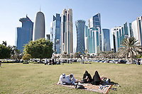 Qatar - Doha - Qatari family having friday picnic along the corniche with the Financial district in the background.