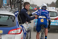Yves Lampaert's (BEL/QuickStep) race radio needs to be replaced mid-race<br /> <br /> 69th Kuurne-Brussel-Kuurne 2017 (1.HC)