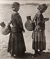 2 Native American women carrying water gourds on their backs, photograph, 19th century, from the National Anthropological Archive, in the Anasazi Heritage Center, an archaeological museum of Native American pueblo and hunter-gatherer cultures, Dolores, Colorado, USA. Picture by Manuel Cohen