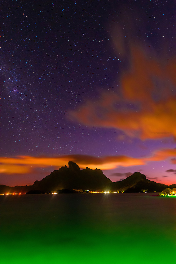 Night scene  with a starry sky looking to Mount Otemanu and Mount Pahia (an extinct volcano) on the island of Bora Bora, Society Islands, French Polynesia.