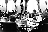 United States President Jimmy Carter, left, and US Secretary of Energy James R. Schlesinger, far right with back to the camera, discuss the CIA report on the international energy situation at a cabinet meeting in the Cabinet Room of the White House in Washington, DC on April 18, 1977.  The President is scheduled to deliver energy address to the nation on live television in the evening.  In his remarks, the President will equate the energy crisis as the &quot;moral equivalent of war.&quot;  From left to right: President Carter, US Secretary of Defense Harold Brown, US Secretary of Commerce Juanita M. Kreps, US Secretary of Labor F. Ray Marshall, Secretary Schlesinger.<br /> Credit: White House via CNP
