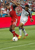 18 July 2012: Toronto FC foward/midfielder Ryan Johnson #9 battles for a ball with Colorado Rapids midfielder Tony Cascio #32 during an MLS game between the Colorado Rapids and Toronto FC at BMO Field in Toronto, Ontario..Toronto FC won 2-1..
