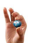 Close-up of a female hand holding the planet Earth 3D model Isolated silhouette over white background Conceptual photo-illustration