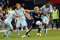 Steven Lenhart (black) forward San Jose Earthquakes holds off the challenge by Birahim Diop midfielder Sporting KC...Sporting KC defeated San Jose Earthquakes 1-0 at LIVESTRONG Sporting Park, Kansas City ,Kansas,..