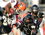 2 September 2006: Syracuse kick returner Curtis Brinkley (22) goes airborne over Wake Forest defenders on the game's opening kickoff. Wake Forest defeated Syracuse 20-10 at Groves Stadium in Winston-Salem, North Carolina in an NCAA college football game.