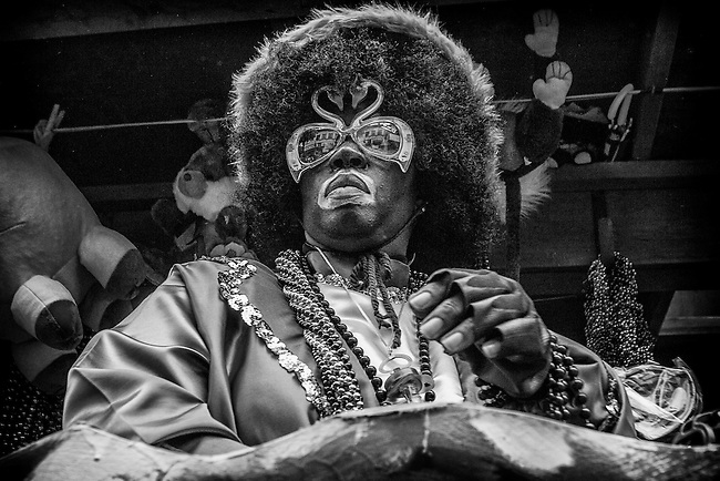 A costumed float rider in the Zulu Social Aid & Pleasure Club's 'Zulu Parade' on Jackson Avenue, the first parade on the morning of Mardi Gras Day on February 12, 2013 in New Orleans, Louisiana.