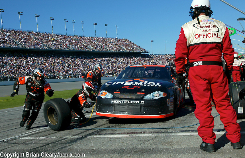 A Winston Cup official oversees a Robby Gordon pit stop during the Daytona 500, Daytona International Speedway, Daytona Beach, FL, February 17, 2002.  (Photo by Brian Cleary/www.bcpix.com)