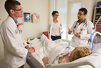 St. Mary's Medical Center. Jonathan Galli, from left, Jenna Pariseau, both class of 2014, Kishore Kumar, M.D., release 20120523001, and patient, release 20120523003.