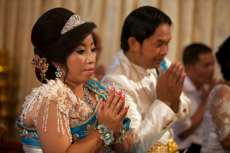 Bride at a Cambodian buddhist wedding in a small village outside of Phnom Penh, Cambodia. <br /> <br /> Photos &copy; Dennis Drenner 2013.