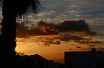 Sunrise behind palm mountain and silhouetted building. San Miguel, Santa Cruz de Tenerife. Canary Islands , Spain.