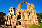 Side chapel wall & bell tower of Fountains Abbey , founded in 1132, is one of the largest and best preserved ruined Cistercian monasteries in England. The ruined monastery is a focal point of England's most important 18th century Water, the Studley Royal Water Garden which is a UNESCO World Heritage Site. Near Ripon, North Yorkshire, England