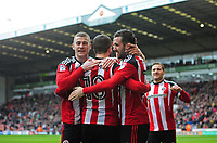 Sheffield United's Danny Lafferty, right, celebrates scoring his sides second goal with team-mates Paul Coutts, left, and Kieron Freeman<br /> <br /> Photographer Chris Vaughan/CameraSport<br /> <br /> The EFL Sky Bet League One - Sheffield United v Charlton Athletic - Saturday 18th March 2017 - Bramall Lane - Sheffield<br /> <br /> World Copyright &copy; 2017 CameraSport. All rights reserved. 43 Linden Ave. Countesthorpe. Leicester. England. LE8 5PG - Tel: +44 (0) 116 277 4147 - admin@camerasport.com - www.camerasport.com