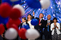 CLEVELAND, OH - JULY 21:  Republican nominee Donald Trump celebrates after the Republican Convention, July 21, 2016 at the Quicken Loans Arena in Cleveland, Ohio.  His is joined by his running mate Mike Pence and his wife Melania   (Photo by Brooks Kraft/ Getty Images)