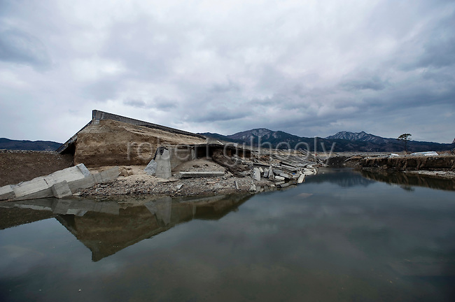 The seawall was smashed during the March 11 tsunami that struck Miyako, Iwate Prefecture, Japan on  3 April 20011.  .Photographer: Robert Gilhooly