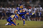 Oxford High's Cody Mills (29) kicks as Harrison Hopper (28) holds vs. Grenada in Oxford, Miss. on Friday, August 17, 2012. Oxford won 28-22.