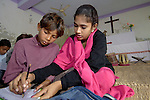 With help from teacher Kanwan Christopher, Shahid Liaqat studies in a school for poor children held in St. Mathew's Church in the Punjab village of Bajasinsingh. This school is sponsored by the Church of Pakistan.