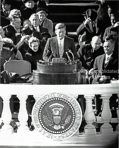 United States President John F. Kennedy delivers his Inaugural Address after being sworn-in as the 35th President of the United States on the East Front of the U.S. Capitol in Washington, D.C. on Friday, January 20, 1961.  U.S. Vice President Lyndon B. Johnson looks on from right..Credit: Arnie Sachs / CNP