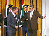 United States President Ronald Reagan, right, escorts President Hosni Mubarak of Egypt, left, following remarks in the East Room of the White House in Washington, D.C. on February 14, 1984..Credit: Arnie Sachs / CNP