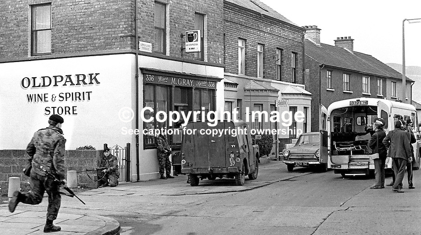 Army, police and ambulance crew at scene of incident in which two policemen were shot dead on 11th November 1971 by the Provisional IRA in an off-licence only 100 yards from Oldpark RUC Station in North Belfast. The police victims were later named as Constable Walter Moore, Londonderry, and Sergeant Dermot Hurley, originally from Wicklow in the Rep of Ireland. Sgt Hurley, a fluent Irish speaker, was the first Roman Catholic member of the RUC to be murdered in the Troubles. 19711110447d.<br /> <br /> Copyright Image from Victor Patterson, 54 Dorchester Park, Belfast, UK, BT9 6RJ<br /> <br /> t1: +44 28 9066 1296<br /> t2: +44 28 9002 2446<br /> m: +44 7802 353836<br /> <br /> e1: victorpatterson@me.com<br /> e2: victorpatterson@gmail.com<br /> <br /> www.victorpatterson.com<br /> <br /> IMPORTANT: Please see my Terms and Conditions of Use at www.victorpatterson.com