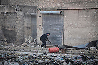 In this Wednesday, Dec. 05, 2012 photo, a Syrian rebel fighter takes cover during heavy clashes in Aleppo, Syria. (AP Photo/Narciso Contreras)