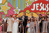 """Dallas, Texas - June 01, 1972. Johnny Cash performing at """"Explo 72"""" with June Carter and her family. The Explo 1972 was an evangelical conference and festival that took place in Dallas, Texas, from June 12 to June 17. The event was sponsored by the Campus Crusade for Christ and organized by Paul Eshleman. A crowd of 80,000 mostly young people from over 75 countries congregated to praise Jesus. An even larger crowd of 180,000 came to the nine hour rock festival that closed the festivities."""