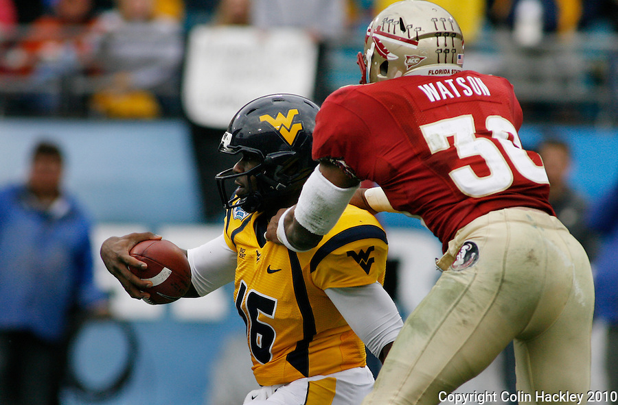 JACKSONVILLE, FL 1/1/10-FSU-WV FB CH29-Florida State's Dekoda Watson sacks West Virginia quarterback Jarret Brown during first half Gator Bowl action Friday in Jacksonville, Fla. .COLIN HACKLEY PHOTO
