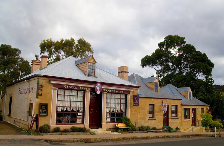 Richmond, Tasmania - the original capital of Tasmania. FORMER STAR & GARTER INN (c1830s) - The left hand cottage of this group of three was the original hotel and is the oldest section.   It now houses ?Olde Time Portraits?...
