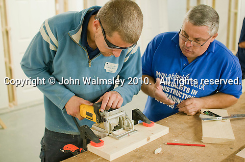 Using the biscuit jointer.  This cuts a small incision in their edges so two lengths of timber can be joined edge to edge by inserting a small biscuit shaped bit of wood between them.   Able Skills in Dartford, Kent, runs courses in construction industry skills like, bricklaying, carpentry and tiling.