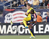 Columbus Crew midfielder Chris Birchall (8) attempts to control the ball as New England Revolution forward Dimitry Imbongo (92) defends. In a Major League Soccer (MLS) match, the New England Revolution defeated Columbus Crew, 2-0, at Gillette Stadium on September 5, 2012.
