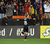 Washington D.C. - April 5, 2014: Chris Rolfe (18) of D.C. United celebrates his score in the 90+ minute of the game.  D.C. United defeated 2-0 the New England Revolution during a Major League Soccer match for the 2014 season at RFK Stadium.