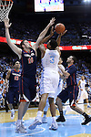 02 February 2015: North Carolina's Kennedy Meeks (3) is defended by Virginia's Mike Tobey (10) and London Perrantes (right). The University of North Carolina Tar Heels played the University of Virginia Cavaliers in an NCAA Division I Men's basketball game at the Dean E. Smith Center in Chapel Hill, North Carolina. Virginia won the game 75-64.