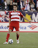 FC Dallas defender George John (14) dribbles the ball.  The New England Revolution drew FC Dallas 1-1, at Gillette Stadium on May 1, 2010