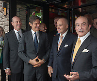 """(L-R) Apple-Metro Pres. Roy Raeburn, Dr. Mehmet Oz, NYPD Commissioner Ray Kelly and Apple-Metro CEO Zane Tankel at the grand opening of the new Applebee's casual dining restaurant in the East River Plaza shopping center in New York on Monday, December 10, 2012. The new restaurant, which is applying for LEED Gold certification, uses rainwater collected from the roof, waterless urinals and contains a """"Living Wall"""" of plants to help purify the air among other eco-friendly features. (© Richard B. Levine)"""