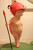 little devil naked boy with red hat and spear