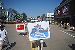 Jason Bouldin walks in the 4th of July parade in Oxford, Miss. on Monday, July 4, 2011.