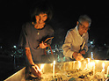 August 6, 2011, Hiroshima, Japan - Residents offer prayers at the cenotaph early in the morning of Saturday, August 6, 2011, hours before the start of a memorial ceremony at Peace Memorial Park in Hiroshima, western Japan.....Japan observed the 66th anniversary of the atomic bombing with a moment of silence and the release of doves in a memorial ceremony as the nation struggles to put a different kind of nuclear disaster under control at the crippled power plant in northeast. The worlds first A-bomb destroyed most of this western industrial city, killing as many as 140,000 people in the summer of 1945. A second atomic bombing Aug. 9 that year in Nagasaki killed tens of thousands more and prompted the Japanese to surrender. (Photo by Natsuki Sakai/AFLO [3615] -mis-