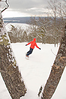 A snowboarder in the extreme backcountry section of Mount Bohemia ski resort in Michigans Upper Peninsula.