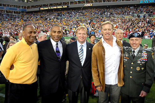 Tampa, FL - February 1, 2009 -- United States Army General David H. Petraeus, Commander, United States Central Command, right, poses for a photo with NFL Hall of Famers Lynn Swann, left, Roger Craig, left center, John Elway, right center, and NFL Commissioner Roger Goodell, center, before the opening kick-off of Super Bowl XLIII in Tampa, Florida on Sunday, February 1, 2009.  .Credit: Bradley Lail - USAF via CNP