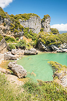 Limestone rock formations on picturesque coastline near Takaka in Golden Bay, Nelson Region, South Island, New Zealand