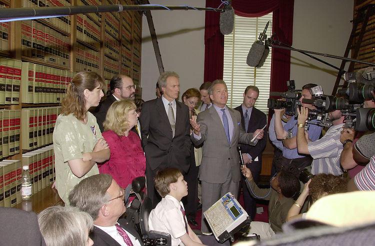 Eastwood C. 5(DG) 051800 -- Clint Eastwood and  Mark Adam Foley, R-FL., during a press conference on Americans with Disabilities Act.