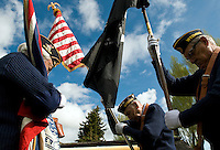 NEWS&GUIDE PHOTO / PRICE CHAMBERS.From left, American Legion members Paul Barbour, Jim VanNostrand and C.A. Poindexter roll up the Wyoming, American and Missing In Action flags after a short ceremony at Post 43 on Monday morning. The American Legion performs several ceremonies around Jackson to commemorate those who have served in the armed forces.