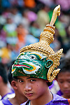 A Royal dancer with his mask lifted on top of his head during the Lao New Year (Pi Mai) parade in Luang Prabang, Laos.