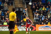 Jack McInerney (9) of the Philadelphia Union goes up for a header with Wells Thompson (15) of the Chicago Fire during a Major League Soccer (MLS) match at PPL Park in Chester, PA, on May 18, 2013.