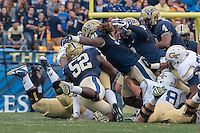 The Pitt defense makes a tackle. Shown are Shakir Soto (52), Darryl Render (91), Todd Thomas (8), and Bam Bradley (4). The Georgia Tech Yellow Jackets defeated the Pitt Panthers 56-28 at Heinz Field, Pittsburgh Pennsylvania on October 25, 2014.